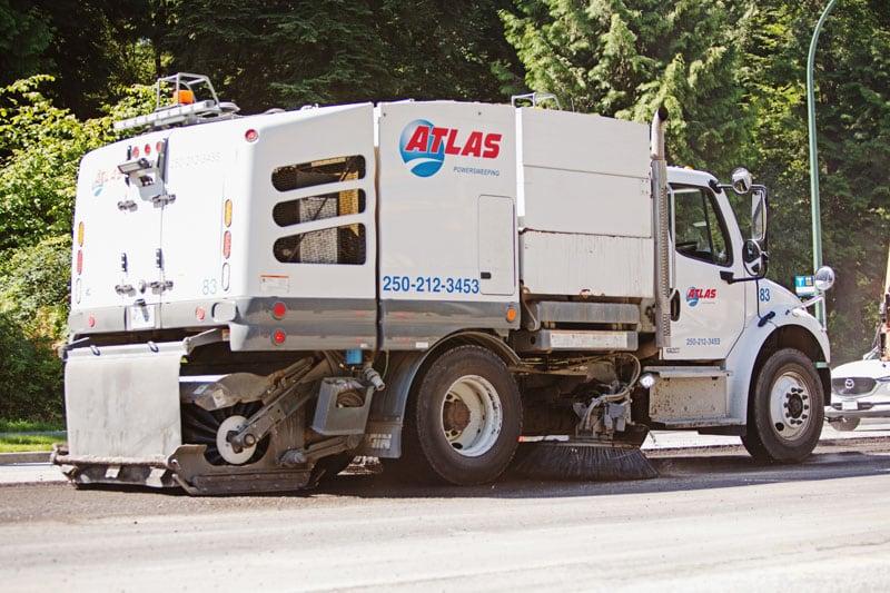 Atlas Power Sweeping truck on road