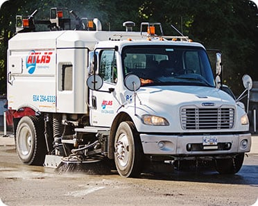 power sweeper truck for parking lot maintenance